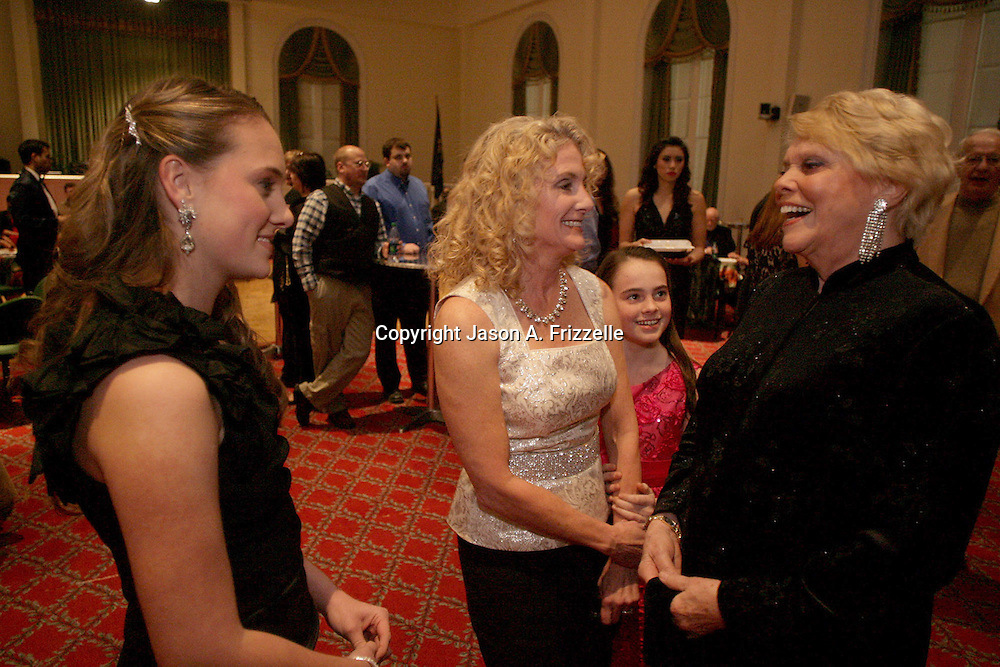 Alexandra Henderson, 17, left, Mary Beth Henderson, center, Stevie Henderson, 11, right-center and Jeanne Criscuolo talk at the Wilmington Theater Awards at Thursday January 23, 2014 at Thalian Hall. (Jason A. Frizzelle)