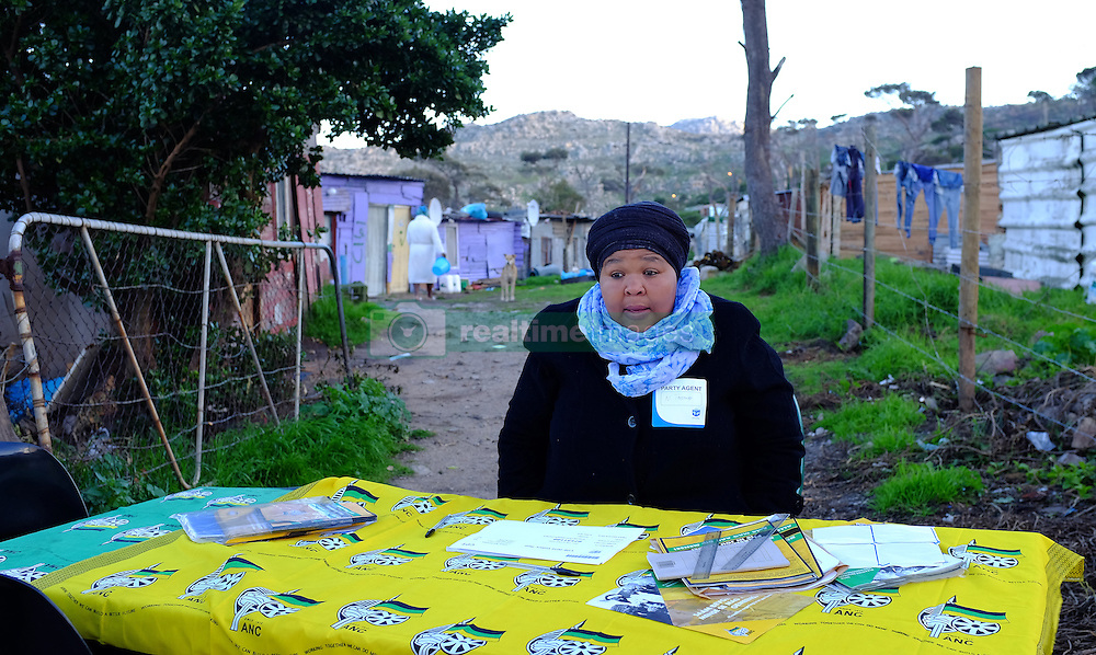 A lone woman mans the ANC voters station as they seek voters to support their party at the Red Hill informal settlement near Simon's Town, Cape Town during the 2016 local government elections held across South Africa on the 3rd August 2016<br /> <br /> Photo by: Ron Gaunt / RealTime Images