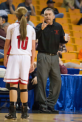 Sissonville head coach Rich Skeen talks with Sissonville guard Karli Pinkerton (10) during a timeout against Clay County during a first round game at the Charleston Civic Center.