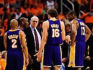 May 29, 2010; Phoenix, AZ, USA; Los Angeles Lakers guard Derek Fisher (2) , guard Kobe Bryant (24) , forward Pau Gasol (16) , center Andrew Bynum (17) talk with head coach Phil Jackson during the second quarter in game six of the western conference finals in the 2010 NBA Playoffs at US Airways Center.  Mandatory Credit: Jennifer Stewart-US PRESSWIRE