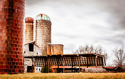 The rear of the Willard Dairy Farm Barn complex was processed with several painterly effect filters and then composited together and finally filtered with a vintage Kodachrome film effect to achieve the finished look.