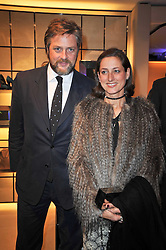 The 10th EARL OF ALBEMARLE and the COUNTESS OF ALBEMARLE at a party to launch the book 'Italian Touch' - A Celebration of Italian Lifestyle held at TOD's, 2-5 Old Bond Street, London on 4th November 2009.
