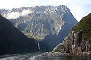 Stirling Falls and a U-shaped glacier valley, Milford Sound, New Zealand