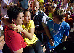 Jelena Jankovic of Serbia carried by her brother Marko when she retires with an injury in her match  against Anastasiya Yakimova of Belarus  at 2nd Round of Singles at Banka Koper Slovenia Open WTA Tour tennis tournament, on July 22, 2010 in Portoroz / Portorose, Slovenia. (Photo by Vid Ponikvar / Sportida)