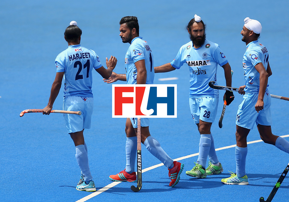 LONDON, ENGLAND - JUNE 25:  Harmanpreet Singh of India celebrates scoring their teams second goal with teammates during the 5th/6th place match between India and Canada on day nine of the Hero Hockey World League Semi-Final at Lee Valley Hockey and Tennis Centre on June 25, 2017 in London, England.  (Photo by Steve Bardens/Getty Images)