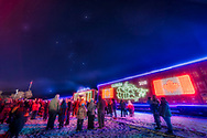 The Canadian Pacific Holiday Train under the stars of winter, including Orion, Taurus and &ndash; just rising at lower left &ndash; Sirius in Canis Major. The train was stopped in Gleichen, Alberta, on December 7, 2018, at 10 p.m. for a half hour stop and musical show with Terri Clark (on stage here) and band. Hundreds of people attended.<br /> <br /> This was a challenge to shoot, to be sure, what with the town lights, the floodlights lighting the stage area, and the lights from the train itself, requiring exposures of a fraction of a second, while the stars needed several seconds. This is a blend of two exposures of 0.4 and 2 seconds, both at ISO 400 at f/2.8. And with the Sony a7III and Laowa 15mm lens. Layers blended with conventional  masks. Plus for the long exposure I covered the lens with my hand to hide the lower area of the image to prevent the lights from glaring too much into the sky, but that helped only a bit. <br /> <br /> And I had fun applying Orton glow effects with ON1 and Luminar, to the ground and to the sky, plus using the Astronomy Tools actions to add the diffraction spikes on the stars and some of the train lights. A duplicated sky layer blended in with Linear Dodge punches up the stars and sky glows around them. So, yes, this all makes for a processed scene to be sure, but it&rsquo;s Christmas! <br /> <br /> And the sky is real and has not been &ldquo;cut and pasted&rdquo; into the scene. The location of the sky at 10 pm was perfect for including the main winter stars above the westbound train.