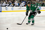 DALLAS, TX - OCTOBER 17:  Jordie Benn #24 of the Dallas Stars tracks down a loose puck against the San Jose Sharks on October 17, 2013 at the American Airlines Center in Dallas, Texas.  (Photo by Cooper Neill/Getty Images) *** Local Caption *** Jordie Benn