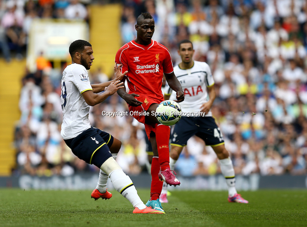 31 August 2014 - Barclays Premier League - Tottenham Hotspur v Liverpool - Mousa Dembele of Tottenham Hotspur in action with Mario Balotelli of Liverpool - Photo: Marc Atkins / Offside.