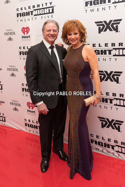 Reba McEntire and Skeeter Lasuzzo attend the Celebrity Fight Night event on March 23, 2019 in Scottsdale, AZ.