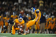 Lafayette High vs. Tupelo's Zach Ellis (14) kicks out of the hold of Tupelo's Jarvis Wilson (7) in Oxford, Miss. on Friday, August 22, 2014. Tupelo won the season opener 20-0.