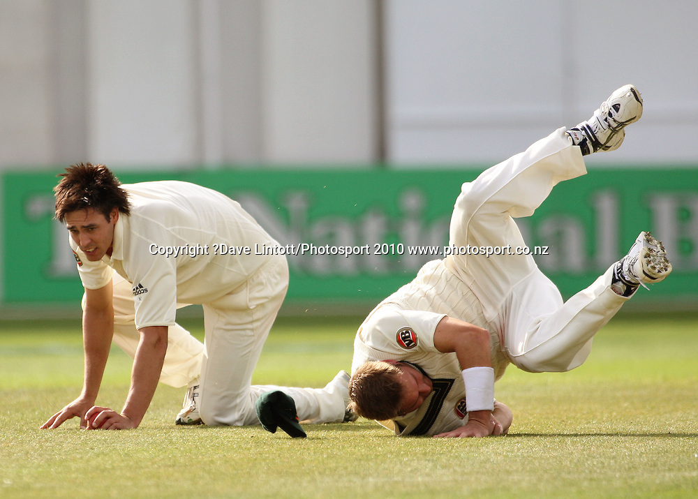 Australia's Mitchell Johnson collides with Ryan Harris.<br /> 1st cricket test match - New Zealand Black Caps v Australia, day three at the Basin Reserve, Wellington.Sunday, 21 March 2010. Photo: Dave Lintott/PHOTOSPORT
