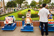 08 MARCH 2006 - Children ride mechanical horses in Ho Chi Minh City, formerly Saigon, South Vietnam. Photo by Jack Kurtz