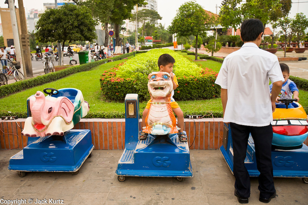 08 MARCH 2006 - Children ride mechanical horses in Ho Chi Minh City, formerly Saigon, South Vietnam. Photo by Jack Kurtz