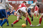 Tom Pope (Bury) is fouled during the Sky Bet League 1 match between Barnsley and Bury at Oakwell, Barnsley, England on 7 February 2016. Photo by Mark Doherty.
