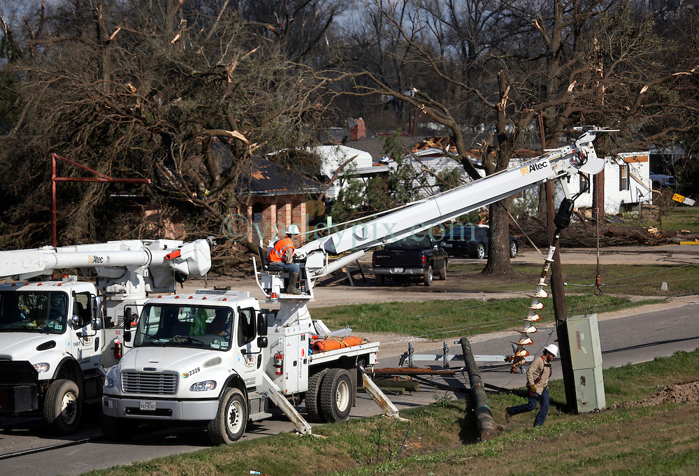 24 February 2016. Sugar Hill RV Park, Convent, Louisiana.<br /> Scenes of devastation following a deadly EF2 tornado touchdown. 2 confirmed dead. <br /> Altec electric repair downed power lines as they struggle to return power to devastated communities. <br /> Photo©; Charlie Varley/varleypix.com