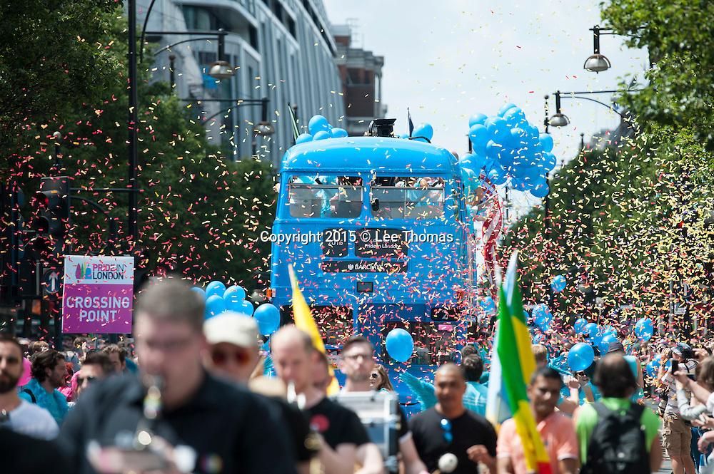 Oxford Street, London, UK. 27th June 2015. Crowds cheer in Oxford Street as several thousand participants take part in this year's London Gay Pride through the streets of the capital. Pictured:  Cheering crowds line Oxford Street as the London Pride Parade passes. // Lee Thomas, Flat 47a Park East Building, Bow Quarter, London, E3 2UT. Tel. 07784142973. Email: leepthomas@gmail.com www.leept.co.uk (0000635435) © Lee Thomas