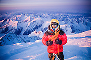 Alaska. Denali National Park. A hiker summits Mt McKinley (20,320 ft) at midnight in April.  MR