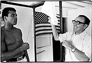 Muhammad Ali - 5th St Gym/Miami Beach, FL      Tri-X     September 1970<br /> training/workout prior to fighting Jerry Quarry in Atlanta (Oct 1970); clowning with Chris Dundee (fight promoter)