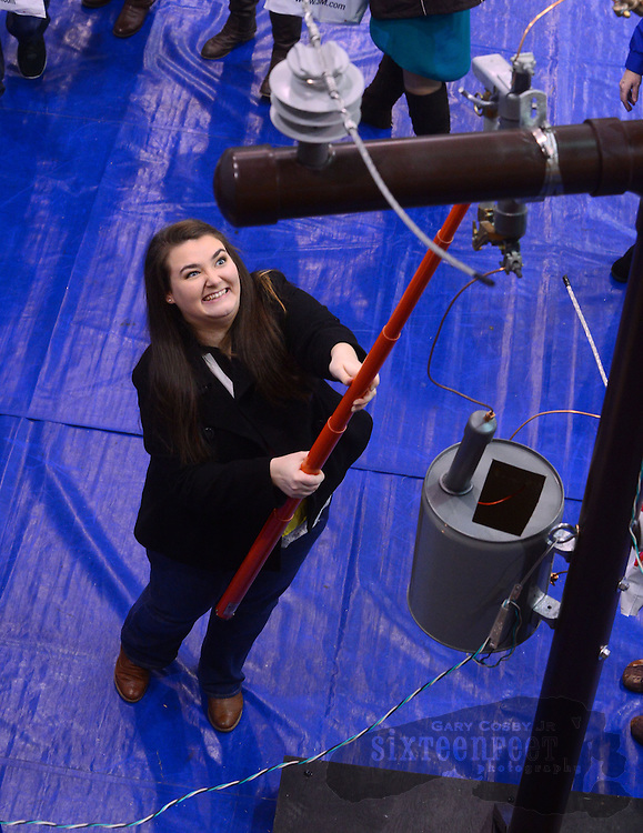 Gary Cosby Jr./Decatur Daily   Students from area high schools participate in the 2014 Workforce Expo at Calhoun Community College Wednesday.  Katie Herchenhahn simulates closing a circuit on a power pole at the Calhoun Lineworker Program booth.