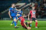 Callum Camps of Rochdale AFC effort on goal blocked by defenders during the EFL Sky Bet League 1 match between Rochdale and Lincoln City at the Crown Oil Arena, Rochdale, England on 17 September 2019.