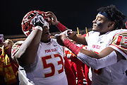 Penn Hills' Anthony Grimes (13) feeds Penn Hills' George Freeman (53) a Hershey chocolate bar in celebration of winning the PIAA Class 5A semifinal game against Archbishop Wood, Friday, Nov. 30, 2018, at Chambersburg High School. The Penn Hills Indians defeated the Archbishop Wood Vikings 20-13, with Penn Hills advancing to the championship in Hershey. (Harrison Jones/Post-Gazette)