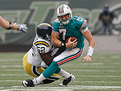 Nov 1, 2009; East Rutherford, NJ, USA; Miami Dolphins quarterback Chad Henne (7) is sacked by New York Jets linebacker David Harris (52) during the 1st half at Giants Stadium. Mandatory Credit: Ed Mulholland