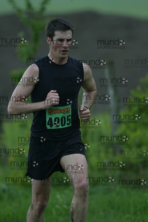"(Kingston, Ontario---16/05/09) ""Olivier Lebeau finshed 1 in the men's 5-6 km Sport Race at the 2009 Salomon 5 Peaks Trail Running series Race held in Kingston, Ontario as part of the Eastern Ontario/Quebec division.""  Copyright photograph Sean Burges/Mundo Sport Images, 2009. www.mundosportimages.com / www.msievents.com."