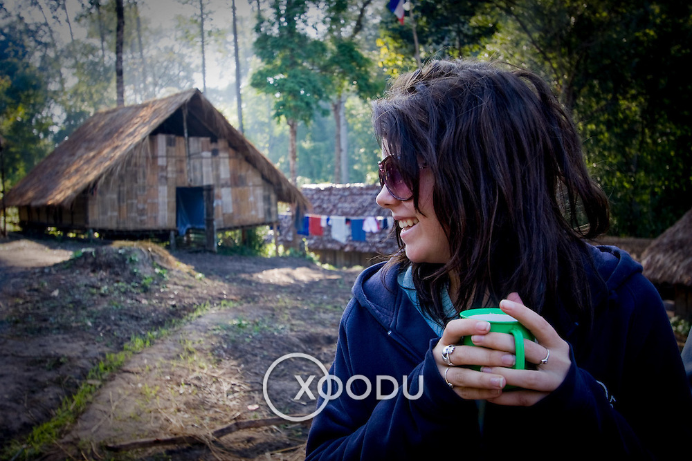 Young female camper enjoying early morning coffee (Maewang district, Thailand - Dec. 2008) (Image ID: 081201-0851201a)