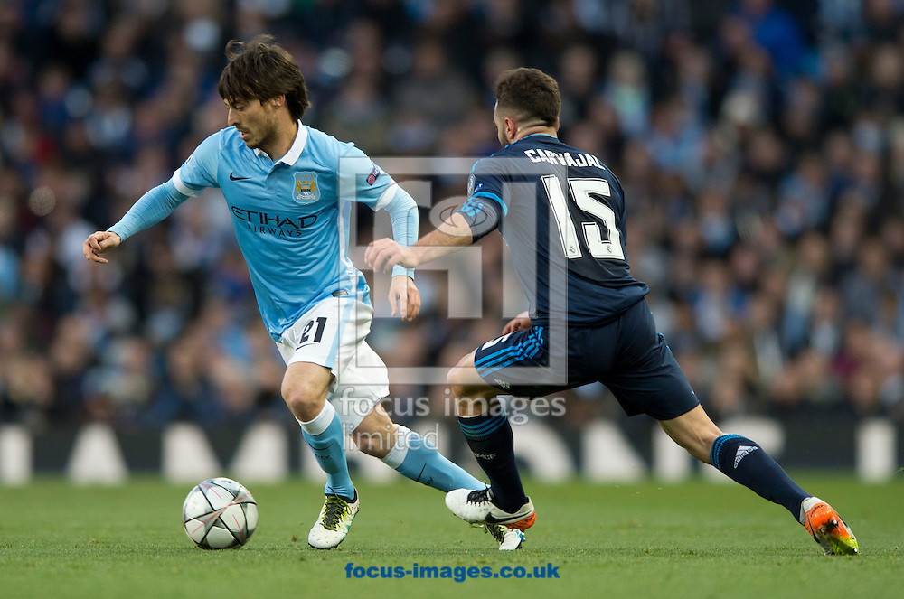 David Silva of Manchester City (left) pulls away from Daniel Carvajal of Real Madrid (right) during the UEFA Champions League match at the Etihad Stadium, Manchester<br /> Picture by Russell Hart/Focus Images Ltd 07791 688 420<br /> 26/04/2016