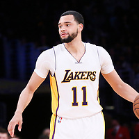 26 March 2016: Los Angeles Lakers guard Tyler Ennis (11) brings the ball up court during the Portland Trail Blazers 97-81 victory over the Los Angeles Lakers, at the Staples Center, Los Angeles, California, USA.
