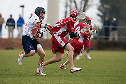 Virginia midfielder Max Pomper (42) attempts to knock the ball away from Stony Brook midfielder Kevin Crowley (21).  The #3 ranked Virginia Cavaliers men's lacrosse team defeated the Stony Brook Seawolves 15-13 at the University of Virginia's Klockner Stadium in Charlottesville, VA on February 23, 2008.