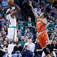 21 December 2012: Boston Celtics shooting guard Jason Terry (4) takes a three point jumpshot over Milwaukee Bucks point guard Monta Ellis (11) during the Milwaukee Bucks 99-94 overtime victory over the Boston Celtics at the TD Garden, Boston, Massachusetts, USA.