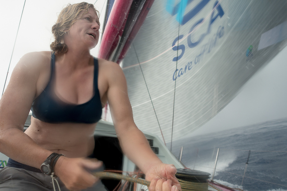 December 5, 2014. Leg 2 onboard Team SCA. Annie Lush trims on the tweaker during a squall