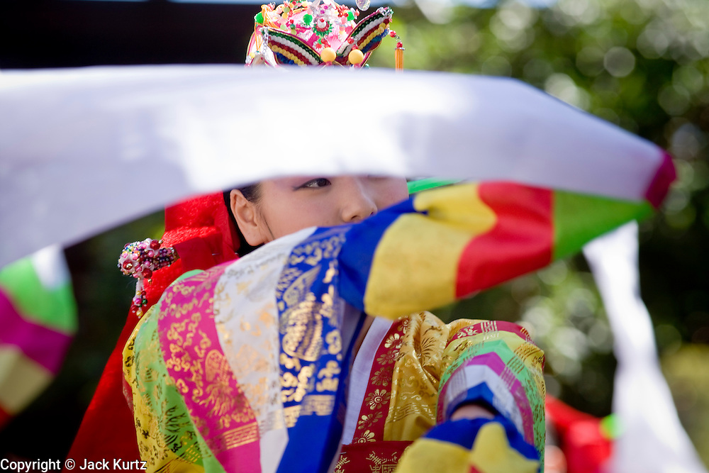 11 MARCH 2007 -- PHOENIX, AZ: Members of the Kah-Yah Korean Traditional Dance Academy perform a Hwa Kwan Moo dance at the Korean Arirang Festival in Phoenix, AZ, Sunday. Arirang is a traditional Korean folk song and is also the name the South Korean overseas broadcast service. The Arirang festival in Phoenix is a celebration of Korean culture. The event is sponsored by the Korean Cultural Center in Arizona.  Photo by Jack Kurtz/ZUMA Press