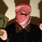 December 23 2003....Rutba, Iraq.....Resistance fighters.....An Iraqi resistance fighter holds up a grenande and a copy of the Koran as he proclaims his willingness to die trying to end the occupation of Iraq by the US. ....