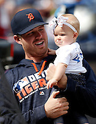 ATLANTA, GA - OCTOBER 2:  Pitcher Buck Farmer #45 of the Detroit Tigers holds a baby girl before the game against the Atlanta Braves at Turner Field on Sunday, October 2, 2016 in Atlanta, Georgia. (Photo by Mike Zarrilli/MLB Photos via Getty Images) *** Local Caption ***