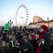 Thousands of Extinction Rebellion activists took over 5 bridges in Central London and blocked them for the day, November 17 2018, Central London, United Kingdom. Westminster Bridge; large crowds blocked to bridge all day with music and speakers and sit-down. Around 11am people on all bridges sat down in the road and blocked traffic from coming through and stayed till late afternoon. The actvists believe that the government is not doing enough to avoid catastrophic climate change and they demand the government take radical action to save future generations and the planet. Many are willing to be arrested peacefully protesting and up to 80 were arrested on the day.Extinction Rebellion is a grass root climate change group started in 2018 and has gained a huge following of people commited to peaceful protests and who ready to be arrested. Their major concern is that the world is facing catastropohic climate change and they want the British government to act now to save future generations.