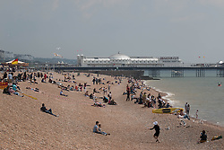 © Licensed to London News Pictures. 01/06/2014. Brighton, UK. The beach is relatively empty compared to some of the last few weekends. Despite a good start to the weekend on Saturday the weather has deterred some people from coming to the beach. Photo credit : Hugo Michiels/LNP