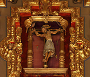Crucifixion sculpture with Christ twisting on the cross, in the Basilica de San Juan de la Cruz, in the Museum of St John of the Cross, or the Museo Conventual y Oratorio de San Juan de la Cruz, Ubeda, Jaen, Andalusia, Spain. St John of the Cross, 1542-91, was a Spanish mystic, Roman Catholic saint, Carmelite friar and priest and one of the Doctors of the Church. Picture by Manuel Cohen