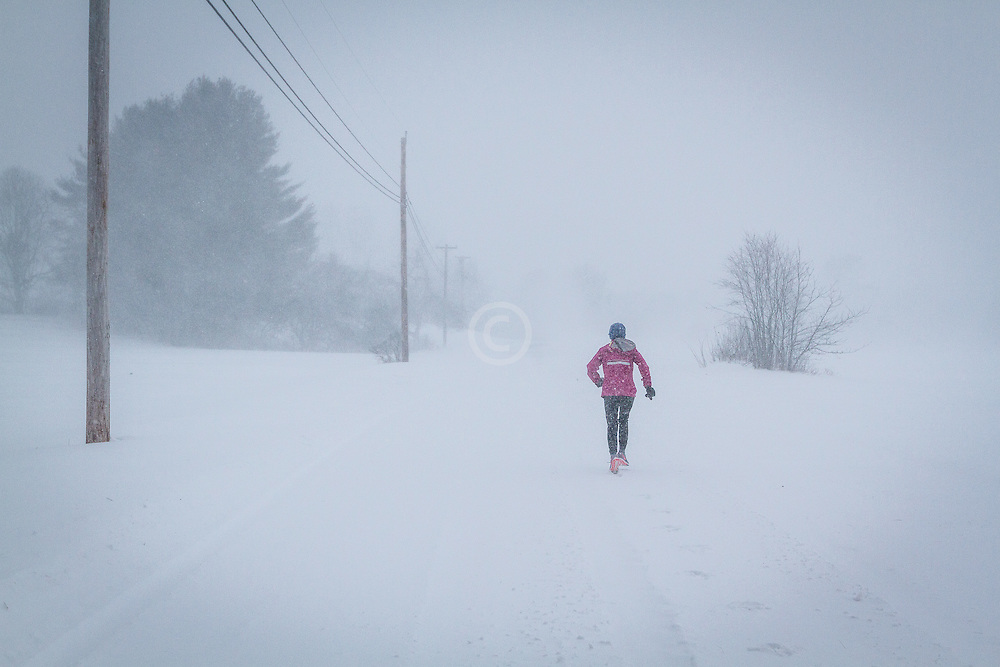 Joan Samuelson runs in blizzard conditions near her home