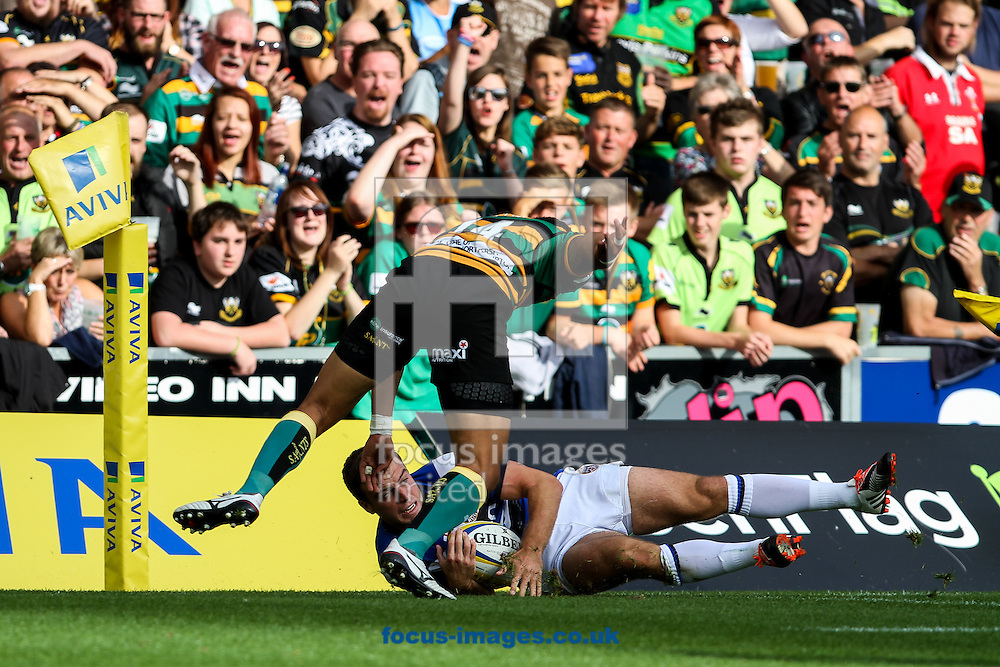 George Ford of Bath Rugby is tackled by Ken Pisi of Northampton Saints (left) during the Aviva Premiership match at Franklin's Gardens, Northampton<br /> Picture by Andy Kearns/Focus Images Ltd 0781 864 4264<br /> 27/09/2014