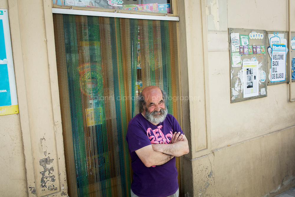GRASSANO, ITALY - 24 JULY 2014: Carmine Donnola, a former alcoholic who has dedicated a poem to Mayor of New York Bill de Blasio, poses for a portrait in Grassano, Mr De Blasio's ancestral home town in Italy, on July 24th 2014. &quot;I decided to dedicate a poem to de Blasio since I know his father was a alcoholic and I know what it means&quot;.<br /> <br /> New York City Mayor Bill de Blasio arrived in Italy with his family Sunday morning for an 8-day summer vacation that includes meetings with government officials and sightseeing in his ancestral homeland.