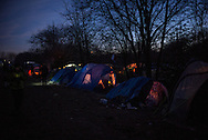 The main road of the camp at dusk. Grande Synthe, France. FEDERICO SCOPPA/CAPTA