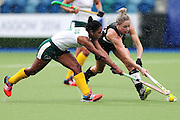Anita Punt of New Zealand competes against Illse Davids of South Africa during the bronze medal match between New Zealand and South Africa. Glasgow 2014 Commonwealth Games. Hockey, Bronze Medal Match, Black Sticks Women v South Africa, Glasgow Green Hockey Centre, Glasgow, Scotland. Saturday 2 August 2014. Photo: Anthony Au-Yeung / photosport.co.nz
