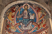 Low angle view of the central apse with mural painting of Christ Pantocrator (replica), Sant Climent de Taull church, 1123, consecrated by bishop of Roda, Taull, province of Lleida, Catalonia, Spain. The church is one of the best examples of Romanesque architecture, known for its murals, which were removed to the MNAC (National Art Museum of Catalonia, Barcelona) in 1922. Sant Climent de Taull is part of the Catalan Romanesque churches of the Vall de Boí which were declared a World Heritage Site by UNESCO in November 2000. Picture by Manuel Cohen.