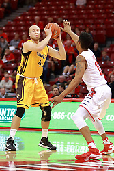 05 November 2016:   Dalton Hoover guarded by Phil Fayne(10) during an NCAA  mens basketball game where the Quincy Hawks lost to the Illinois State Redbirds in an exhibition game at Redbird Arena, Normal IL