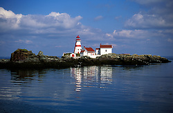 Located on the eastern tip of Campobello Island, the now unmanned East Quoddy Light (also known as Head Harbour Lighthouse) is considered to be the most photographed lighthouse in the world.  It looks out over Passamaquoddy Bay and the Bay of Fundy.