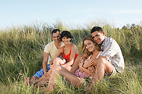 Two Couples Relaxing on Dunes