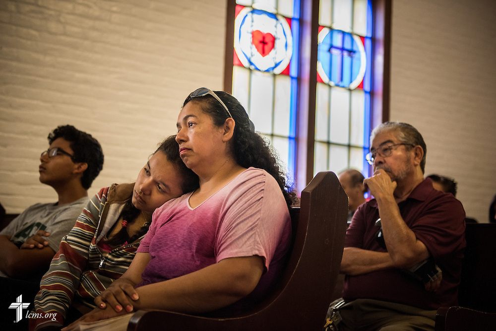 Dalila Garcia lays her head against Maria Gonzalez during worship at El Calvario Lutheran Church on Sunday, April 17, 2016, in Brownsville, Texas. LCMS Communications/Erik M. Lunsford