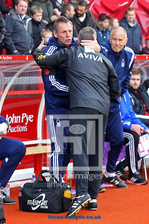 Nottingham Forest Manager Stuart Pearce and Norwich Manager Neil Adams before the Sky Bet Championship match at the City Ground, Nottingham<br /> Picture by Paul Chesterton/Focus Images Ltd +44 7904 640267<br /> 08/11/2014